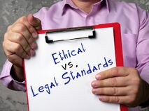 Financial concept about Ethical vs. Legal Standards with phrase on the page