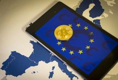 Financial concept with golden Bitcoin over smartphone, with EU flag, symbol and map Stock Photos