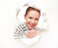 Financial concept, happy woman with money in hands dollorov peeking through a hole in a blank white paper Stock Image
