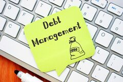 Financial concept meaning Debt Management with sign on the piece of paper