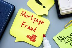 Financial concept about Mortgage Fraud with sign on the piece of paper