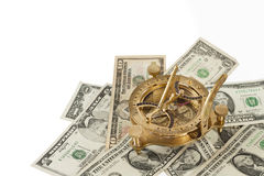 Financial concept. Old brass navigation sextant on dollar bills. Stock Photo