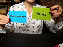 Financial concept about Renewable Energy with sign on blank business cards