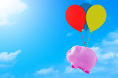 Financial Concept, Saving Money. Financial, saving money concept, pink piggy bank on blue sky background stock images