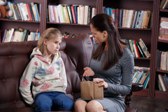 Financial conflict of girl and mother Royalty Free Stock Image