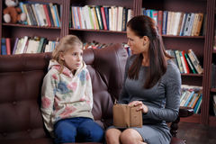 Financial conflict of girl and mother Stock Images