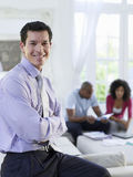 Financial Consultant With Couple In Background Royalty Free Stock Image