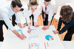 Financial consultants in bank analyzing data Stock Photography
