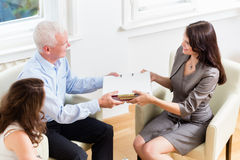 Financial consulting - customer handing over documents Royalty Free Stock Image
