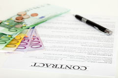Financial contract with pen and money. On the document Stock Photos