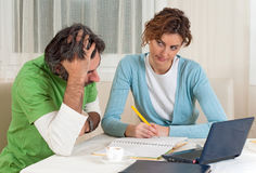 Financial Couple Stressing and Planning Royalty Free Stock Images