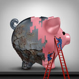 Financial Credit Recovery. Business concept as a woman and man as bank or banking advisers repairing an old rusted piggy bank with a fresh coat of paint as a Stock Photos