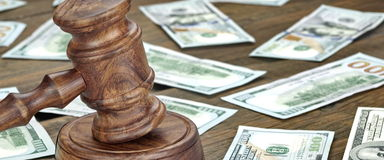 Financial Crime or Auction Concept With Gavel And Money Backgrou. Financial Crime or Fraud or Auction Concept Image With Judges Gavel or Auction Hammer And Money Stock Photo