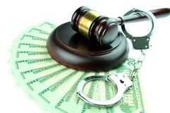 Financial crime concept. With gavel and handcuffs on money background Stock Images