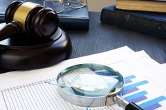 Financial crime. Gavel and Magnifying glass with business documents. Fraud. Financial crime. Gavel and Magnifying glass with business documents. Fraud concept royalty free stock photography