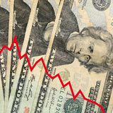 Financial crisis. A red line graph with a downward trend and twenty dollar bills in the background Stock Photo