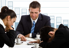 Financial crisis. Disappointed businesspeople in financial crisis Stock Image