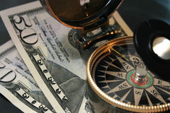 Financial crisis. Navigating compass against 100 dollars Stock Images