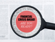 Financial crisis ahead under magnifying glass Royalty Free Stock Images