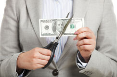 Business concept with dollars and scissors Stock Photos