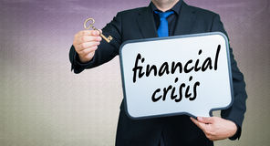 Financial crisis businessman. A businessmann with a whiteborad text is financial crisis Stock Images