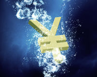 Financial crisis concept. Yen sign sink in clear blue water Royalty Free Stock Photo