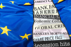 Financial Crisis in Europe. Newsletters Headlines about Financial Crisis With Flag of European Union Stock Images