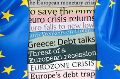 Financial Crisis in Europe. Newsletters Headlines about Financial Crisis With Flag of European Union Stock Photo