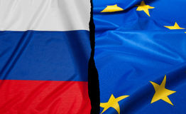 Financial Crisis in Europe. Crisis in Europe - Russian Flag and Flag of European Union royalty free stock photo
