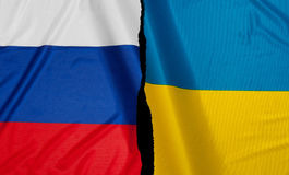 Financial Crisis in Europe. Crisis - Russian Flag and Ukrainian Flag royalty free stock photo