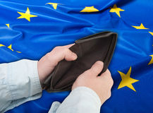 Financial Crisis in European Union. Financial Crisis in EU - Man's Hand With Empty Wallet and Flag of European Union Royalty Free Stock Photos