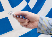 Financial Crisis in Greece. Man's Hand With Banking Card Greek flag stock photography
