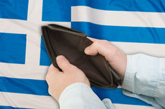Financial Crisis in Greece. Man's Hand With Empty Wallet and Greek flag stock images