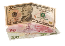 Financial crisis: new ten dollars over thirty crumpled turkish liras Royalty Free Stock Photo