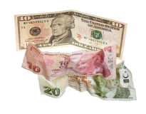 Financial crisis: new ten dollars over thirty crumpled turkish liras. Isolated on white Royalty Free Stock Image