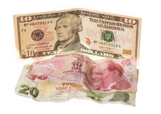 Financial crisis: new ten dollars over thirty crumpled turkish liras Stock Photos