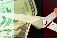 Scissors cutting American currency twenty dollar bill - Budget cuts financial crisis concept Stock Photos