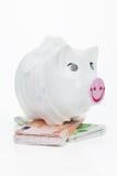 Financial crisis. Sick piggy bank on euro notes. Royalty Free Stock Image