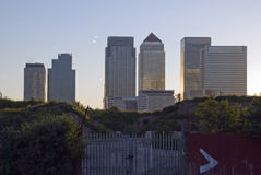 Financial Crisis sunset. Photo of London Canary Wharf Corporate buildings with an abandoned lot in the foreground. Real photo from the South side of the river Royalty Free Stock Photography