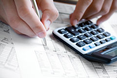 Financial data analyzing. Counting on calculator Royalty Free Stock Photos