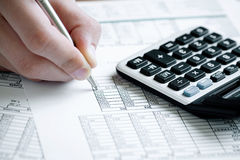 Financial data analyzing. Counting on calculator Royalty Free Stock Image