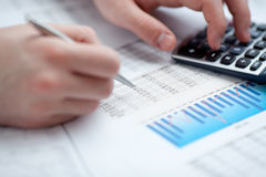 Financial data analyzing. Counting on calculator. Close-up. Selective focus Royalty Free Stock Photography