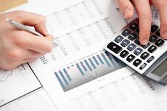 Financial data analyzing. Counting on calculator. Royalty Free Stock Photography