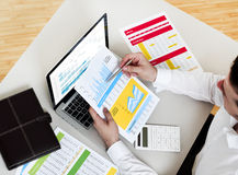 Financial data. Businessman working on financial data royalty free stock image