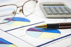 Financial data concept. Business background, financial data concept with pen and glasses Stock Images