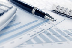 Financial data concept with pen Stock Photo