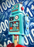 Financial data. Concept with retro toy robot Royalty Free Stock Images
