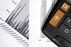Financial Data and Graph. This is an image of a calculator, financial data, and financial graphs stock images