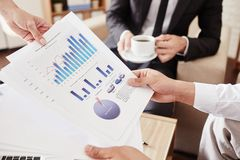 Financial data. Male employee holding papers with financial data Stock Photography