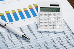 Financial Data Sheet With Calculator And Pen Royalty Free Stock Photo